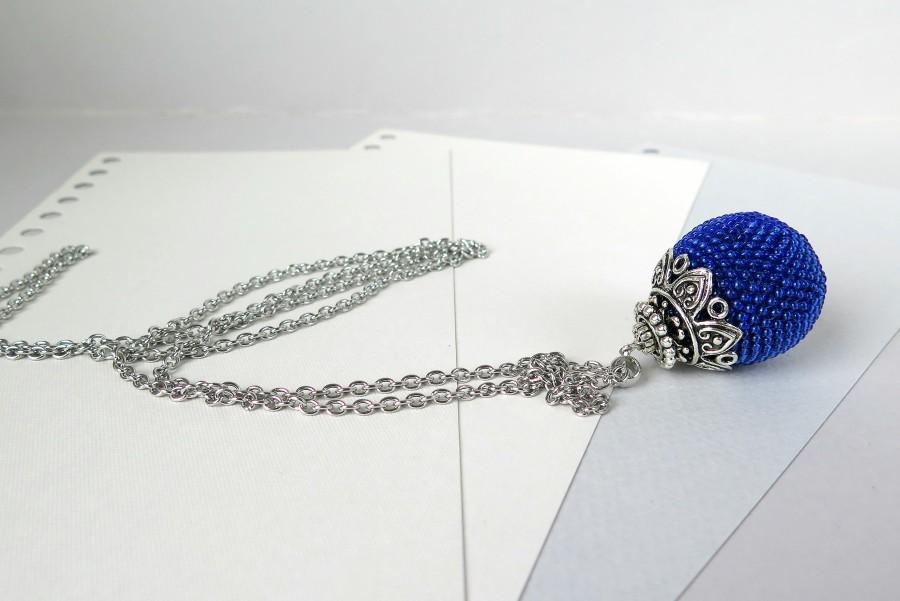 Ryškiai mėlynas pakabukas burbulas